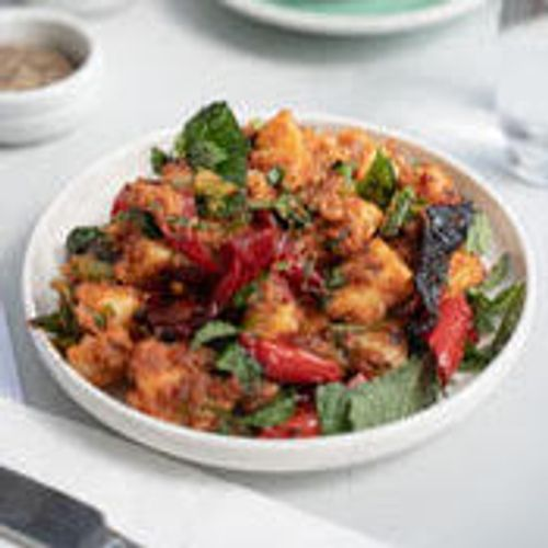 Potato, Roast Tomato, Olive, Spiced Salca Paste, Red Peppers And English Spinach